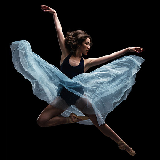 A dancer leaps in the air