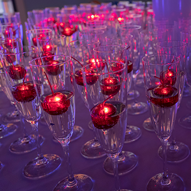 Red candles floating in champaign glasses