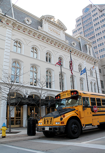 School bus parked in front of Victoria Theatre