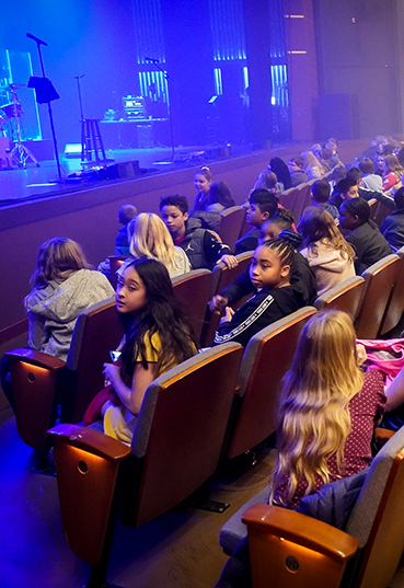 Students waiting for a performance at the Schuster Center to begin.