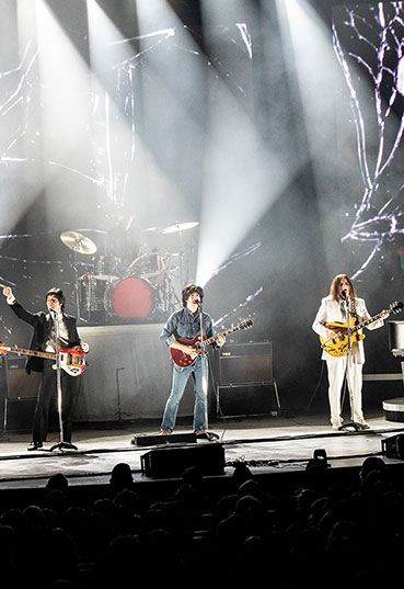 Musicians perform as The Beatles