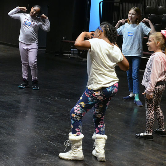 Children learning acting techniques