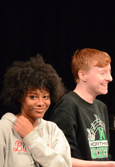 Acting students laugh in an acting class