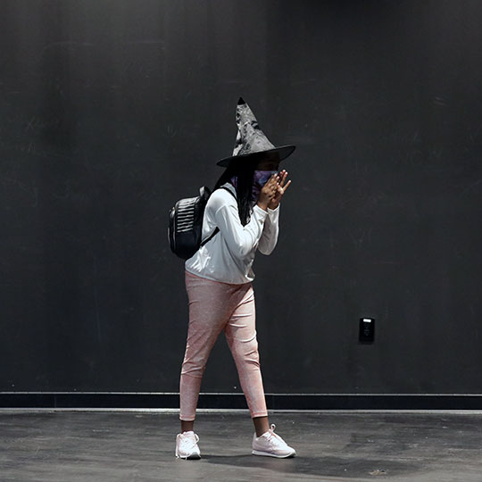 A child pretends to be a wizard in an acting class